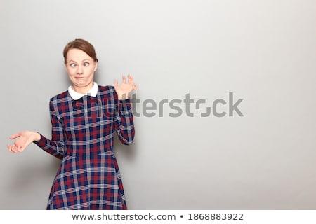 Portret onzeker jong meisje jurk grijs Stockfoto © deandrobot
