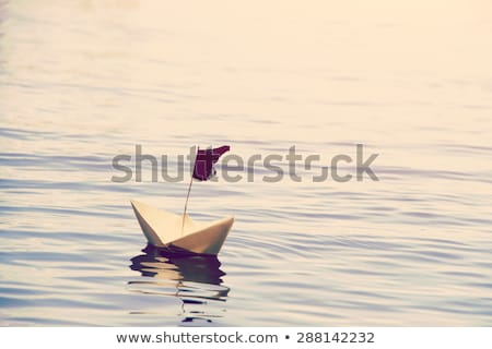Toy boat floating on water Stock photo © colematt