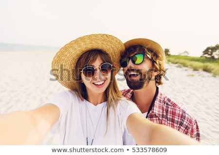 Photo stock: Emotional Young Friends Outdoors Take Selfie By Phone