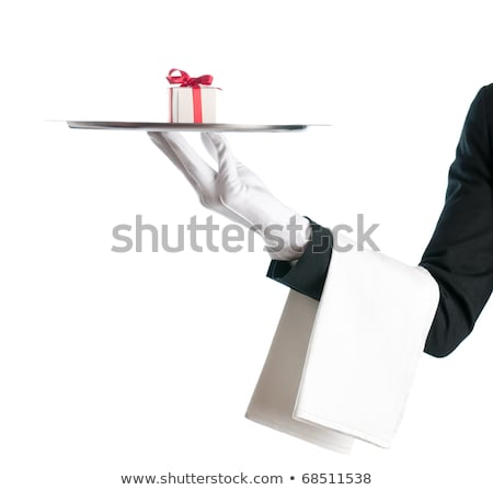 Waiter holds a Christmas present in a tray. Isolated on white background Stock photo © alphaspirit