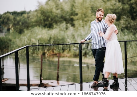 bride standing on the river pier stock photo © ruslanshramko