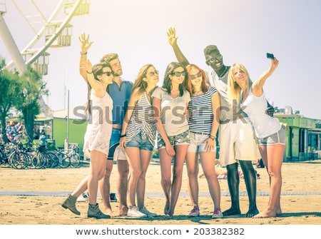 international friends taking selfie in park stock photo © dolgachov
