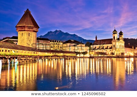 Luzern Kappelbrucke bridge and church with Pilatus mountain back stock photo © xbrchx