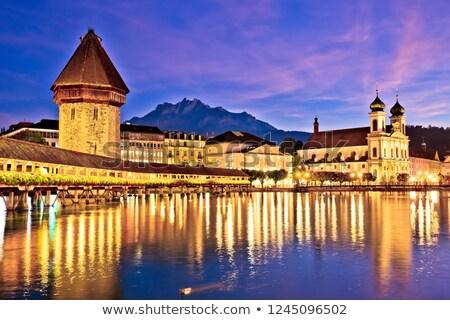 Luzern Kappelbrucke bridge and church with Pilatus mountain back Stock photo © xbrchx
