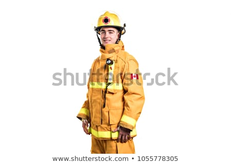Picture from a young firefighter on studio white wall stock photo © Lopolo