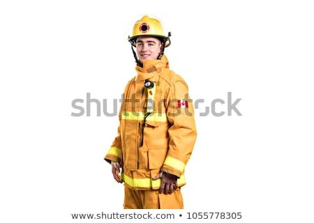 Foto jóvenes bombero estudio blanco pared Foto stock © Lopolo
