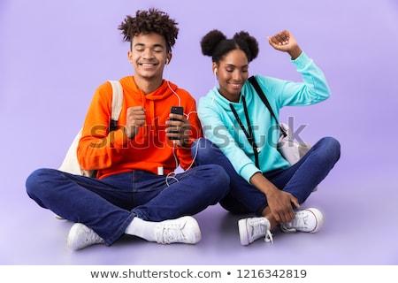 Afroamerikai fivér lánytestvér visel okostelefon fülhallgató Stock fotó © deandrobot