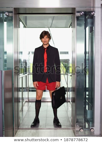 Image of european businessman 30s in black jacket looking at cam Stock photo © deandrobot