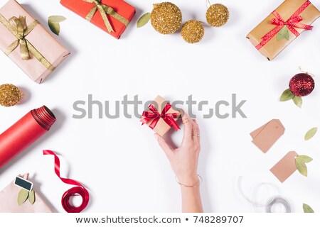 Female Woman hand wrapping white gift with yellow ribbon Stock photo © Illia