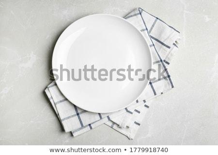 Empty plate with napkin Stock photo © karandaev