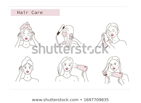 Stock photo: Beautiful woman in bathroom take care of her hair with dryer.