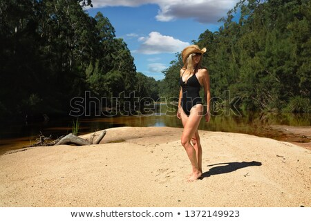 Aussie woman in bikini  in bushland river bank Stock photo © lovleah