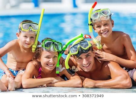 Dad and son have fun in the pool Stock photo © galitskaya