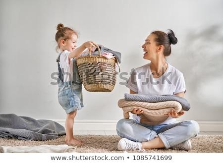 Donna basket abbigliamento lavanderia ragazza sorriso Foto d'archivio © Elnur