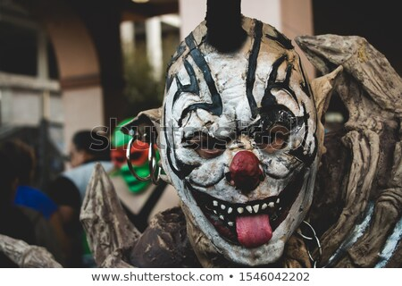 Stockfoto: Scary Evil Clown Sticking Out His Tongue