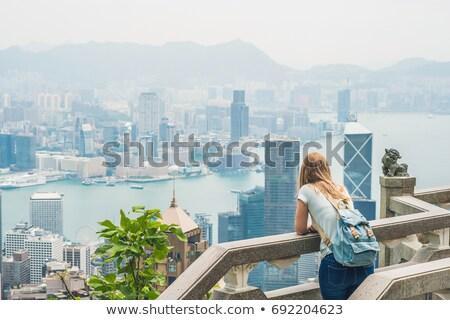 若い女性 旅人 ピーク 背景 香港 建物 ストックフォト © galitskaya