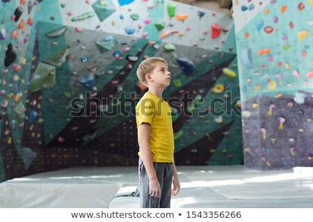 Sporty youngster in activewear standing in the middle of climbing room Stock photo © pressmaster