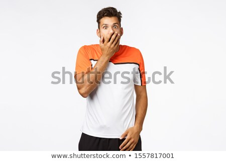 Man overheard rumours, shocked and astonished. Masculine handsome young sportsman found out secret,  Stock photo © benzoix