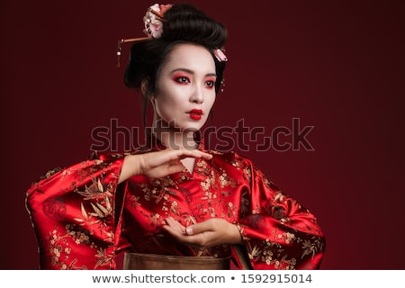 Image of young geisha woman in traditional japanese kimono danci Stock photo © deandrobot