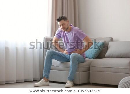 Homem sofrimento dor de estômago quarto jovem dormir Foto stock © AndreyPopov