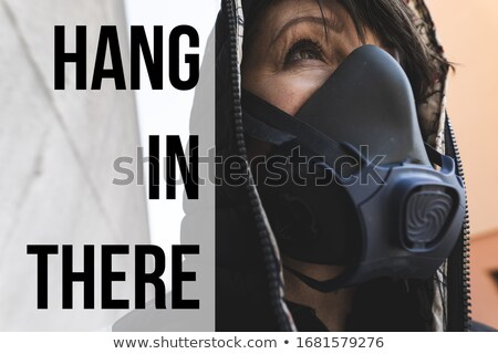 woman surviving pandemic  with a gas mask on the street Stock photo © Giulio_Fornasar