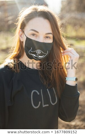 beautiful happy girl trying on a mask to protect against a dangerous virus Stock photo © ruslanshramko