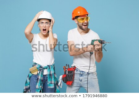 Homme constructeur forage image Photo stock © deandrobot