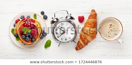Delicious pancakes with berries and jam, croissants and coffee Stock photo © karandaev