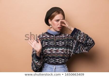 Fotografia niezadowolony kobieta kolczyki Zdjęcia stock © deandrobot