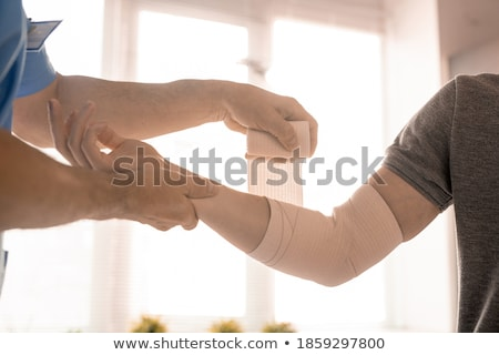 Main blessés Homme corps rouge plâtre Photo stock © KonArt