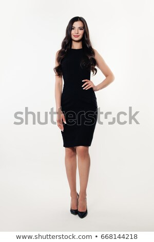 Attractive young woman in a black dress stock photo © filipw