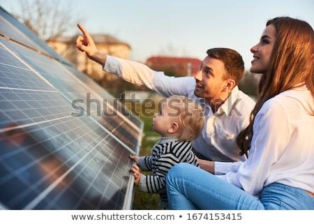 Stok fotoğraf: Güneş · enerjisi · ev · maskot · güneş · panelleri · el · yüz