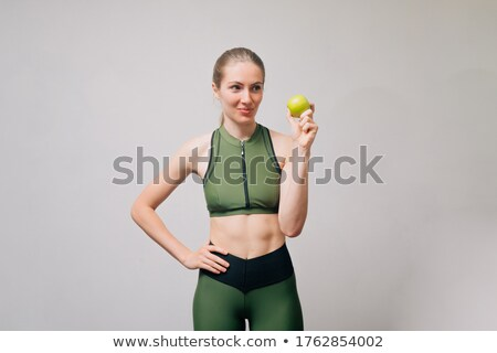 Fitness theme. beautiful woman is measuring her waist Stock photo © Pilgrimego