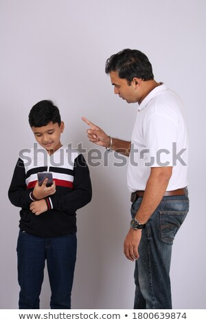 Dad scolding his son, father with son isolated on white  Stock photo © dacasdo