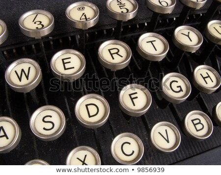 Stock photo: Close Up Of Keys On A Dirty Old Nicotine Stained Typewriter