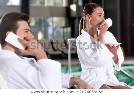 Woman enjoy cup of coffee in spa center Stock photo © imarin