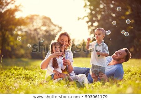 幸せな家族 自然 日没 花 蝶 女性 ストックフォト © pkdinkar