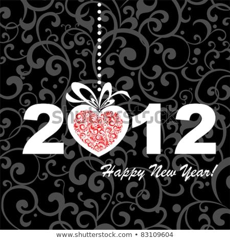 2012 vecteur nouvelle ans carte de vœux suspendu Photo stock © aispl