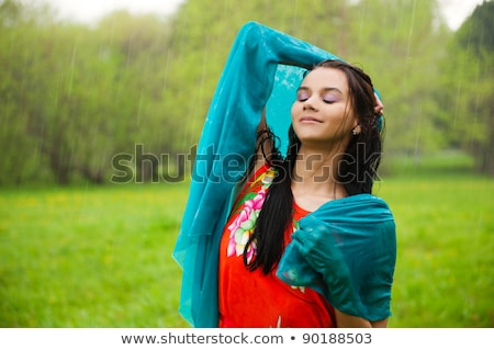 Woman enjjoying rain at summer park she is free and vulnerable Stock photo © HASLOO