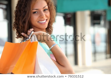 Smiling Metis woman carrying shopping bags Stock photo © photography33