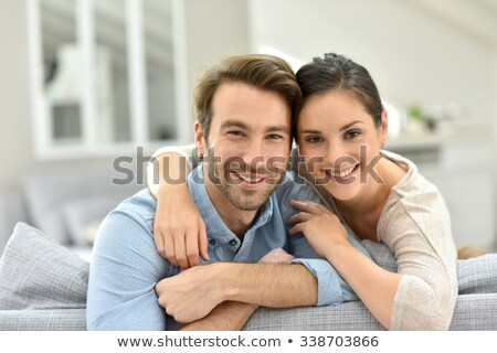 a 35 years old couple sitting on a couch Stock photo © photography33