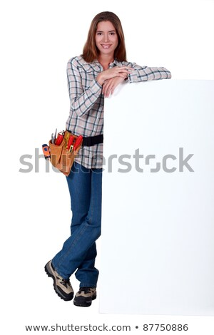handywoman standing behind a blank sign stock photo © photography33