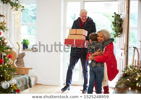 Woman at a front door with a gift Stock photo © photography33