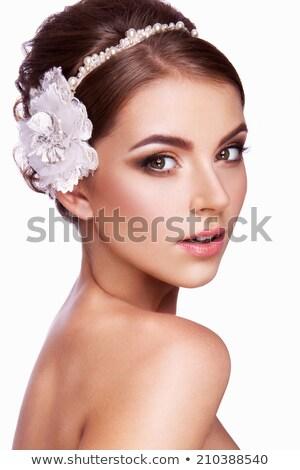 Brunette schoonheid poseren bloem meisje glimlach Stockfoto © konradbak