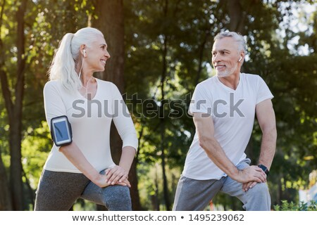 Elderly couple warming up Stock photo © photography33