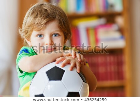 Little boy watching his favourite sports team Stock photo © foto-fine-art