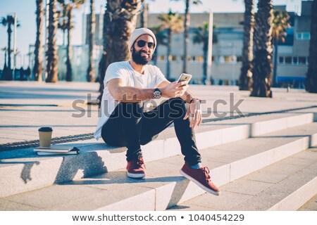 Młody człowiek odkryty posiedzenia modlić młodych samotny Zdjęcia stock © AndreyKr