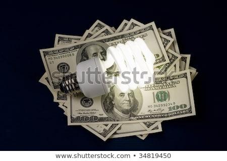 Stockfoto: Compact Fluorescent Lightbulb And Dollar