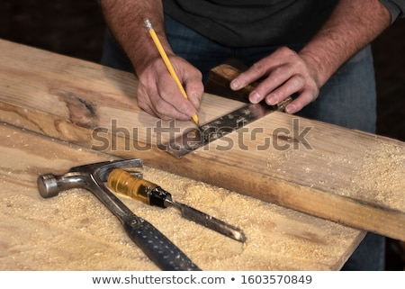tradesman marking a measurement on a wooden plank stock photo © photography33