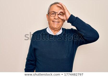 Old man looking through binoculars Stock photo © photography33